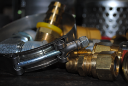 Our selection of products includes the brass and stainless steel fittings and adapters shown as well as the many sizes of clamps shown.