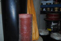 Sirco Industrial warehouse at 2127 Caughey Road in Erie, PA holds rolls of various sizes and types of sheet rubber as shown.