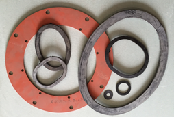 Several sizes and shapes of gaskets are shown in a pile on Sirco Industrial's customer service counter.