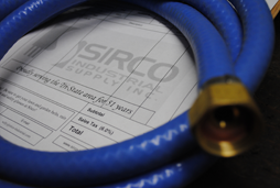 Sirco Industrial Supply customized hose with brass fittings is made to order for a local manufacturing company.