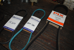 Shown are an automotive timing belt for a boat, a conveyor belt and a v-belt at our store.
